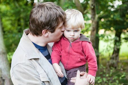 Young father and sweet baby boy in spring forest on sunny warm day Stock Photo - 17563208