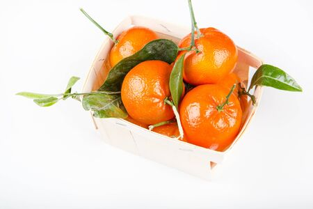 Wood rustic crate full of clementine mandarin oranges  Horizontal format isolated on white background Stock Photo - 17640548