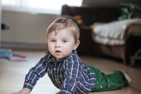 Adorable baby boy learning crawling indoor Stock Photo - 17600754