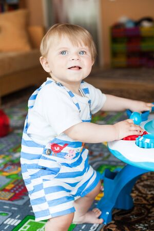 Little toddler boy playing with  toys indoor Stock Photo - 17600759