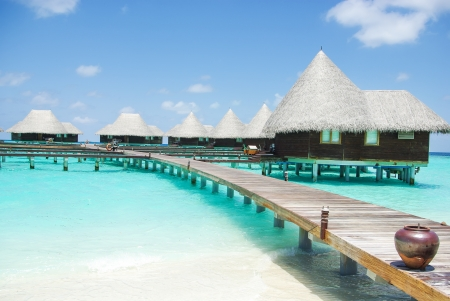 Water villas on tropical caribbean island, Maldives