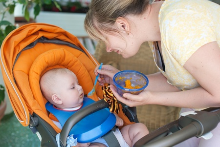 snotty: Adorable baby boy first time eating meal with carrots