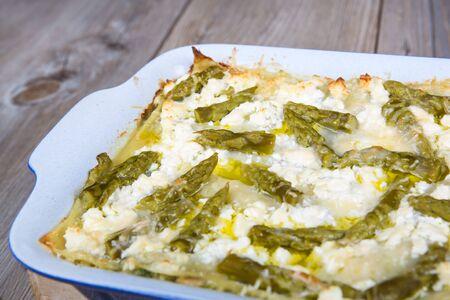 Fresh vegetarian lasagna with green asparagus photo