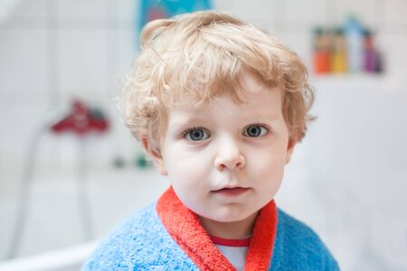 Adorable little toddler boy after taking a bath in bathtub Stock Photo - 17973038