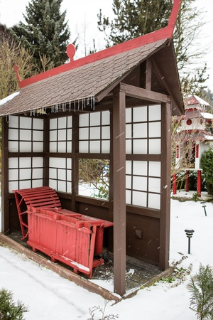 selfmade: Selfmade Japanese garden during snowfall in winter, Germany Stock Photo