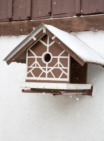 Bird box under snow during the cold winter photo