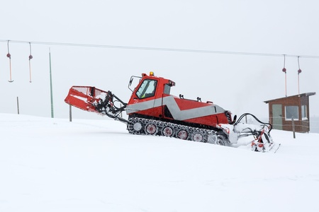 snow grooming machine: Snowplow working on a ski slope in Germany Stock Photo