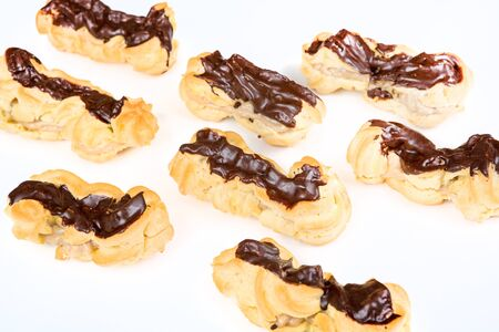 Fresh baked eclairs with coffee cream inside and chocolate Stock Photo - 18140990