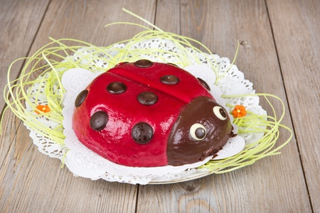 ladybeetle: Ladybird cake on wooden background for Easter or birthday Stock Photo