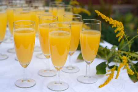 Glasses with champagne and orange juice on wedding greeting Stock Photo