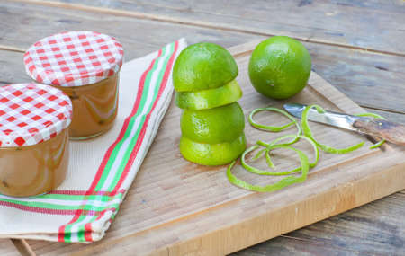 Homemade lemon and lime jam in a glass jar and fresh fruits Stock Photo - 18977733