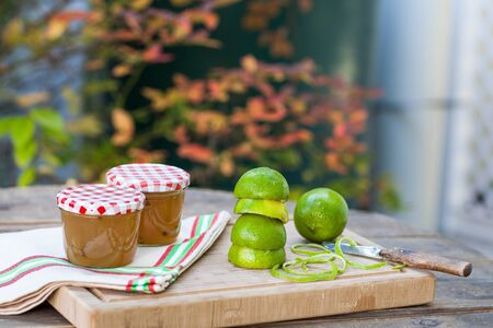 Homemade lemon and lime jam in a glass jar and fresh fruits Stock Photo - 18977724