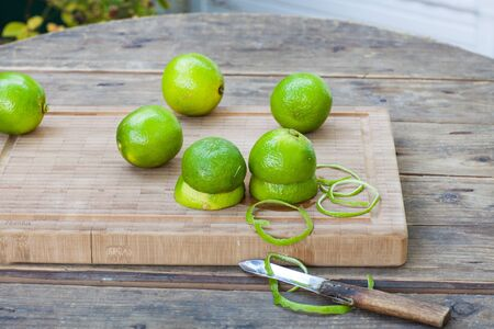 Fresh ripe limes on wooden background Stock Photo - 18977722