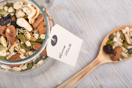 Homemade healthy muesli with different nuts and oats photo