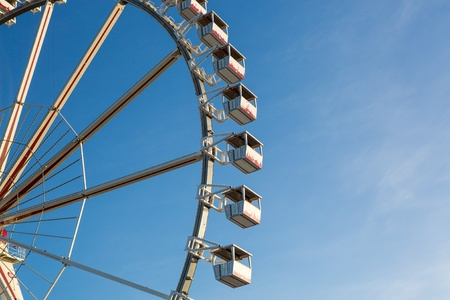 Cabins of a Ferris Wheel with blue sky photo