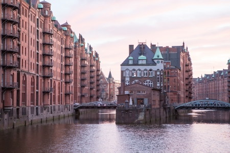 Historic Speicherstadt (houses and bridges) at the evening in Hamburg photo