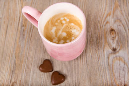 Cup of fresh coffee on wooden background photo