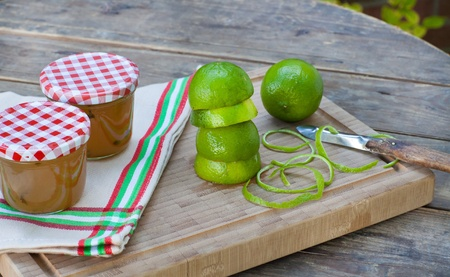 Homemade lemon and lime jam in a glass jar and fresh fruits Stock Photo - 21639372