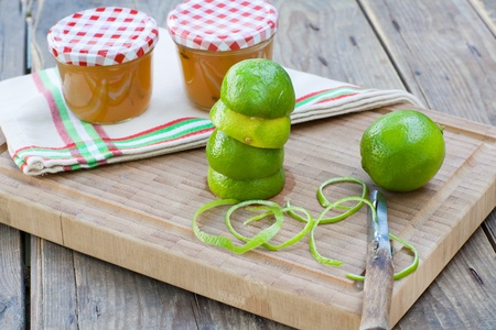 Homemade lemon and lime jam in a glass jar and fresh fruits Stock Photo - 21639376