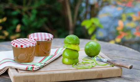 Homemade lemon and lime jam in a glass jar and fresh fruits Stock Photo - 21639396
