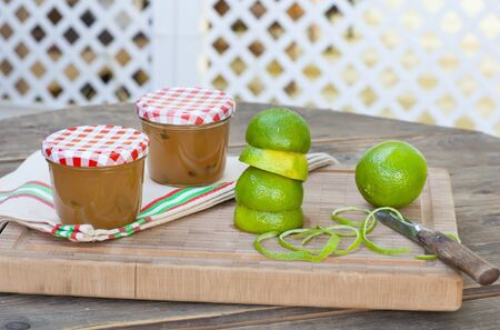Homemade lemon and lime jam in a glass jar and fresh fruits Stock Photo - 21639397