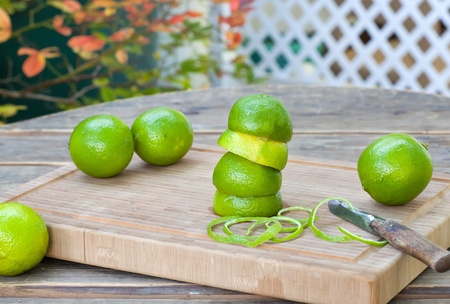 Fresh green ripe limes on old wooden table Stock Photo - 21639399