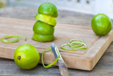 Fresh green ripe limes on old wooden table Stock Photo - 21639400