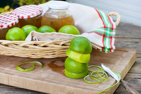 Homemade lemon and lime jam in a glass jar and fresh fruits Stock Photo - 21639401