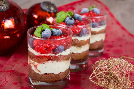 Christmas dessert: Sweet dessert tiramisu with strawberry, fresh blueberry and mint creme Stock Photo