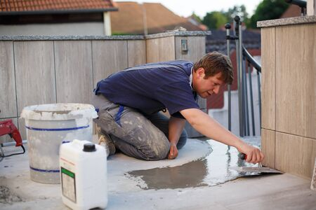 modernise: Man working on roof Stock Photo