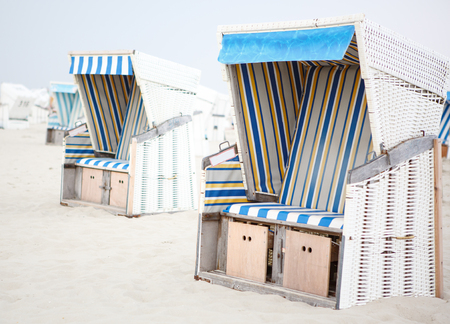 Colorful beach chairs with stripes at the beach of St.Peter Ording, Germany photo