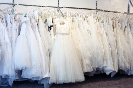 Collection of wedding dresses in the shop.