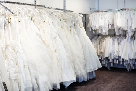 Collection of wedding dresses in the shop. photo
