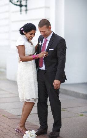 Beautiful indian bride and caucasian groom, after wedding ceremony photo