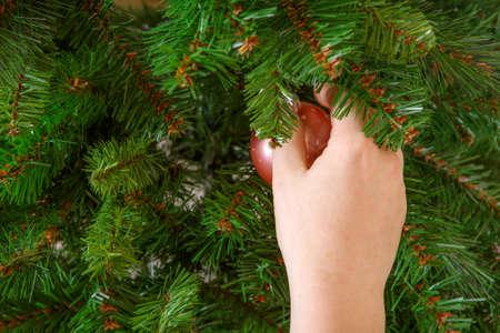 Hand hanging christmas tree toy photo