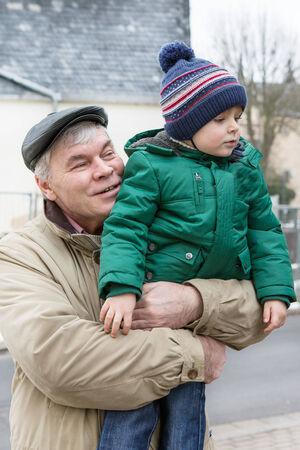 Grandfather with grandchild having fun outdoors Stock Photo - 24629165