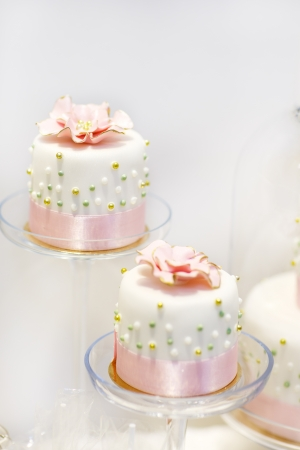 Wedding cakes in cream and pink with pearls photo