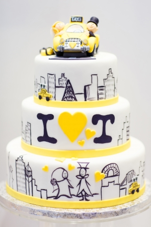 tiered: Wedding cake decorated with bride Stock Photo