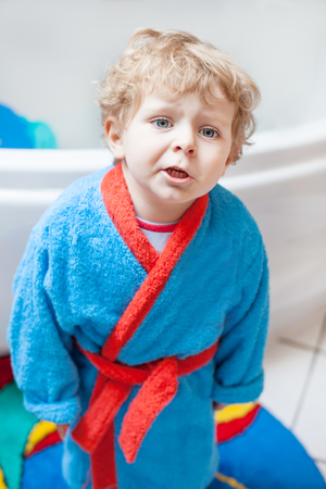 Adorable little toddler boy after taking a bath in bathtub photo