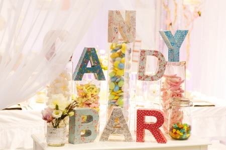 Sweet table as candy bar with different sweets on dinner or event party photo