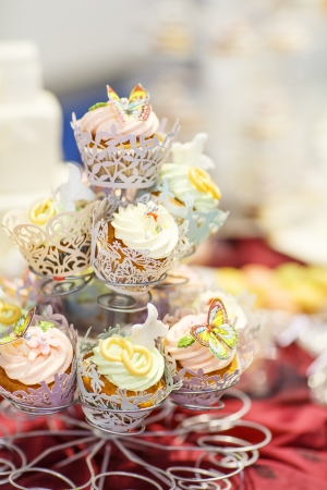 Elegant sweet table with cupcakes and other sweets for dinner or event party photo