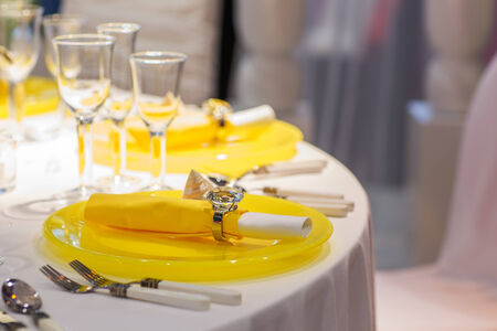banquet table: Elegant table set in soft creme and yellow for wedding or event party Stock Photo