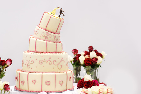 tiered: Delicious beautiful wedding cake in white , creme and pink.