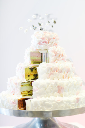 Delicious beautiful wedding cake in white , creme and pink.