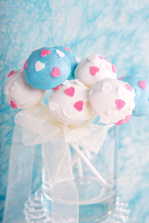 Delicious wedding cake pops in white and soft blue photo