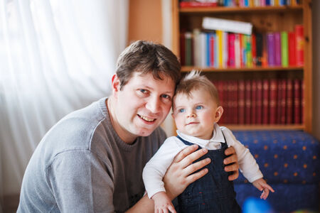 six months: Young father and little baby boy of six months, indoor.