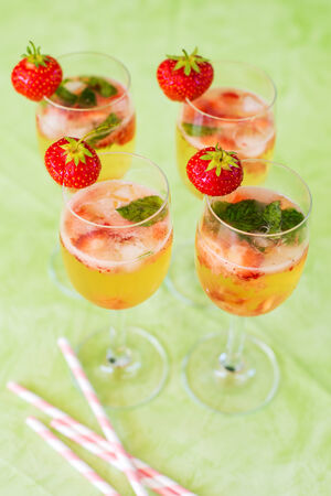 Fresh home made summer cocktail with champagne, peppermint and fresh strawberries photo
