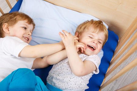 Family Of Two Little Boys Twins Having Fun Playing And Fighting Stock Photo Picture Royalty Free Image 27510728