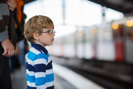 Happy little boy in a subway station Stock Photo