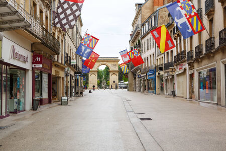 DIJON, FRANCE - JULY 6, 2014: The Guillaume gate on Darcy square in Dijon, France. Dijon is a city in eastern France, and is the capital of the Burgundy region.